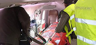 Ebola patients placed in the Putins capsule  - protective transport bag for infected patient